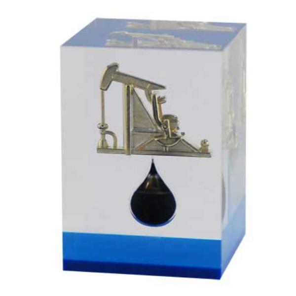 """Пресс-папье классический подарок деловому человеку, коллегам, партнерам. Для вас мы производим пресс-папье на разные темы. Сейчас разрабатывается и находится в процессе производства коллекция подарочных пресс-папье для нефтяной, нефтеперерабатывающей отрасли, для энергетиков. Наши пресс-папье, несмотря на низкую цену, изготовлены из натуральных материалов, без имитаций. Стекло, хрусталь, сталь, цветные металлы мы используем для производства. В этом разделе представлены уже готовые к нанесению вашей фирменной символики пресс-папье """"Бочка нефти"""", стеклянное пресс-папье """"Нефтяной станок-качалка"""", """"Нефтяной глубинный насос"""". Все эти деловые подарки могут быть выпущены ограниченным тиражем с модификацией дизайна именно для ваших целей. Т.е. мы можем произвести Бочку нефти баррель не черного а к, примеру, красного или синего цвета по Pantone. Рядом со станком-качалкой в объеме оптического стекла мы разместим ваш логотип, выполненный по технологии трехмерной лазерной гравировки в стекле. Производство идет на нашем парке оборудования, поэтому сроки и стоимость подарков по индивидуальному дизайну не сильно отличаются от складских."""